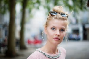 Woman with messy topknot