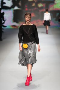 Woman walks the catwalk with a fanny pack