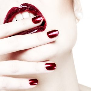 Red nails and matching lips